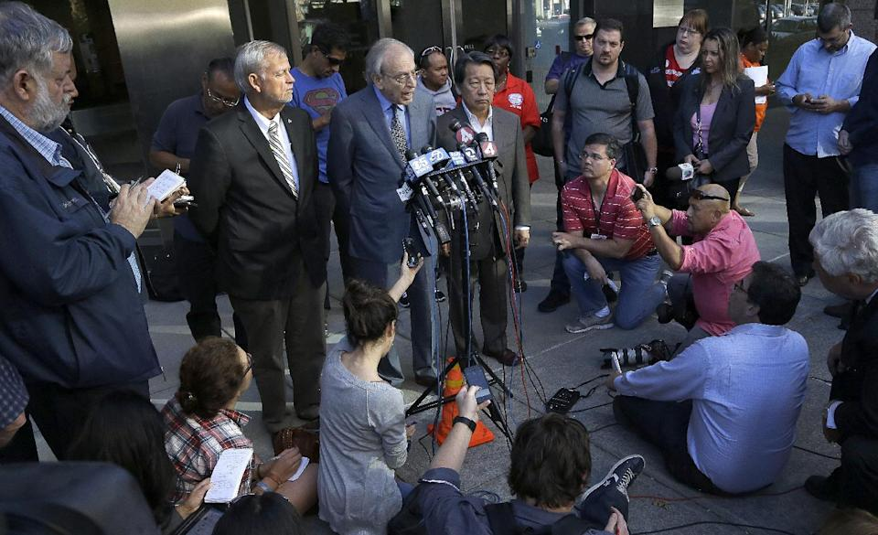 Federal mediator George Cohen, center, speaks during a news conference on Thursday, Oct. 17, 2013, in Oakland, Calif. San Francisco Bay Area Rapid Transit workers may go on strike at midnight unless management agrees to enter into arbitration to resolve a remaining issue, a union leader said Thursday. (AP Photo/Ben Margot)