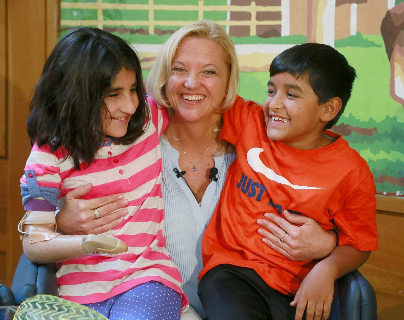 Nurse reunited with injured Afghan children she helped