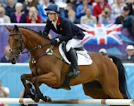 Great Britain finished second in the three-day eventing on Tuesday to earn a silver medal for Queen Elizabeth II's granddaughter Zara Phillips, with Germany taking the top spot and New Zealand claiming bronze