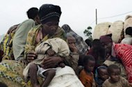 "File picture shows refugees displaced from the Democratic Republic of Congo at a camp in Uganda. UN sanctions experts have ""overwhelming evidence"" that Rwanda has breached an arms embargo to aid rebels in the Democratic Republic of Congo, according to a report obtained by AFP"