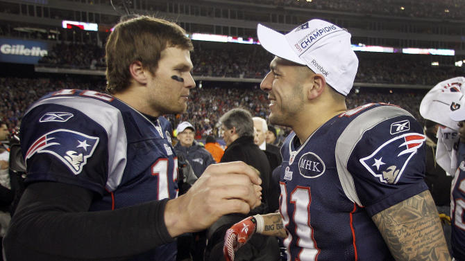 New England Patriots quarterback Tom Brady, left, congratulates  Aaron Hernandez after their AFC Championship NFL football game against the Baltimore Ravens Sunday, Jan. 22, 2012, in Foxborough, Mass. The Patriots defeated the Ravens 23-20 to win the AFC Championship. (AP Photo/Charles Krupa)