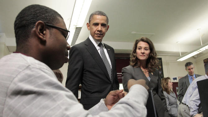 President Barack Obama watches a student during his visit to classrooms at TechBoston Academy with Melinda Gates, center, in Boston, Tuesday, March, 8, 2011. Melinda Gates is the co-chair of the Bill and Melinda Gates Foundation.(AP Photo/Pablo Martinez Monsivais)