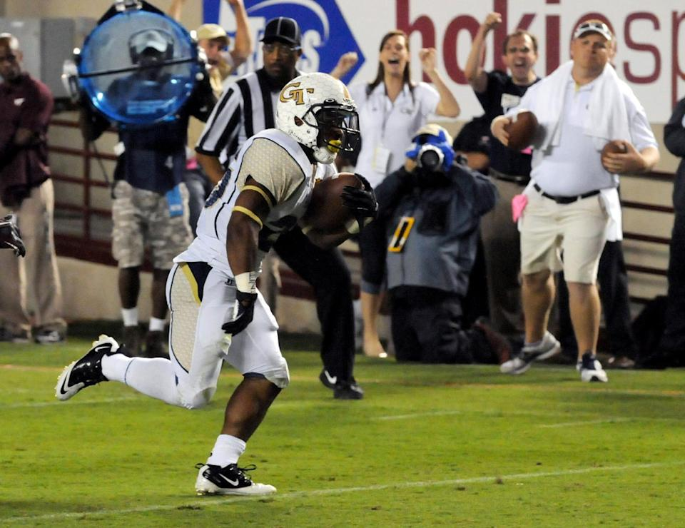 Georgia Tech's Robert Godhigh scores a touchdown against Virginia Tech during the first half of an NCAA college football game, Monday, Sept. 3, 2012, in Blacksburg, Va. (AP Photo/Don Petersen)