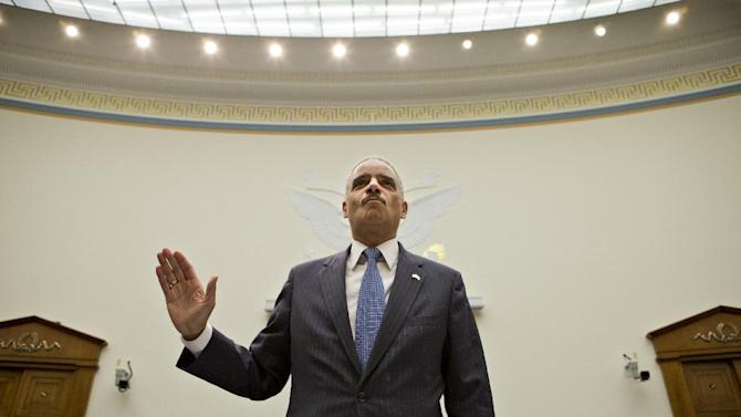 Attorney General Eric Holder, the nation's top law enforcement official, is sworn in on Capitol Hill in Washington, Wednesday, May 15, 2013, prior to testifying before the House Judiciary Committee oversight hearing on the Justice. Department. House Judiciary Committee Chairman Rep. Bob Goodlatte,R-Va., wants to know more about the unwarranted targeting of Tea Party and other conservative groups by the Internal Revenue Service and the Justice Department's secret seizure of telephone records at The Associated Press.  (AP Photo/J. Scott Applewhite)