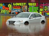A vehicle sits outside a flooded car dealership lot after dikes on the Salmon River gave way in Truro, Nova Scotia on Monday, Sept. 10, 2012. The area is under a rainfall warning as Tropical Storm Leslie churns toward Atlantic Canada. Leslie is expected to make landfall in Newfoundland bringing heavy rain and high winds. (AP Photo/The Canadian Press, Andrew Vaughan)