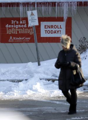 A woman leaves the KinderCare Learning Center on Thursday, …