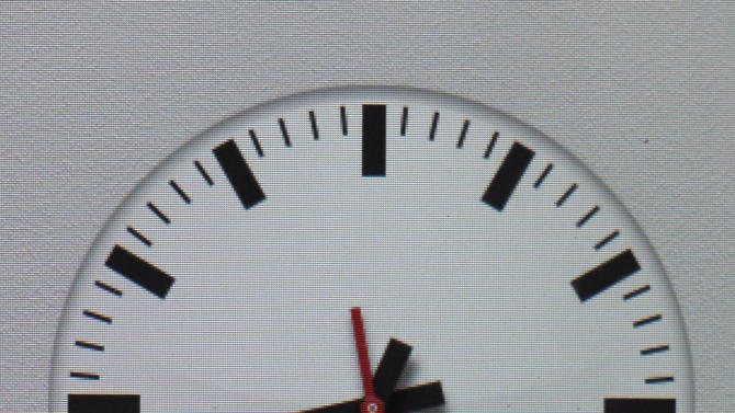 A clock symbol is displayed on an iPad with the new iOS 6 Friday, Sept.21, 2012 in Nauen, eastern Germany. Switzerland's national rail company is accusing Apple Inc. of stealing the iconic look of its station clocks for the iOS 6 operating system used by iPhone and iPad mobile devices. Both designs have a round clock face with black indicators except for the second hand which is red. (AP Photo/Ferdinand Ostrop)