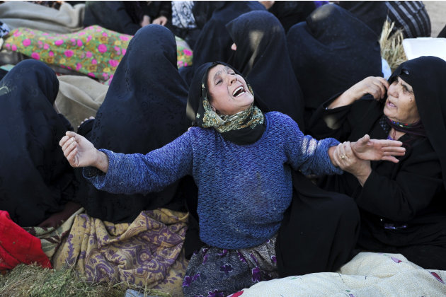 An Iranian woman grieves after her loved ones were killed during Saturday's earthquake at the village of Bajebaj near the city of Varzaqan in northwestern Iran, Sunday, Aug. 12, 2012. Twin earthquakes