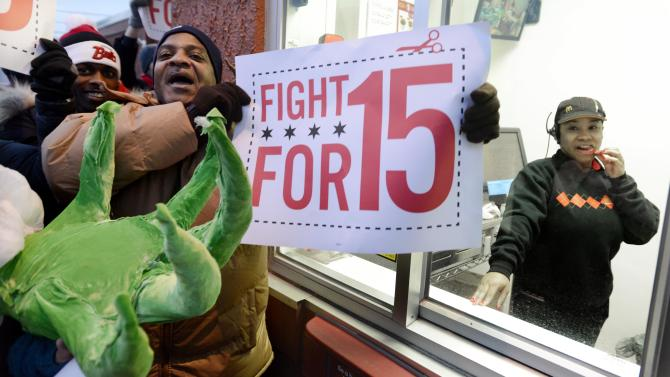 Demonstrators rally for better wages outside a McDonald's restaurant in Chicago, Thursday, Dec., 5, 2013. Demonstrations planned in 100 cities are part of push by labor unions, worker advocacy groups and Democrats to raise the federal minimum wage of $7.25. (AP Photo/Paul Beaty)