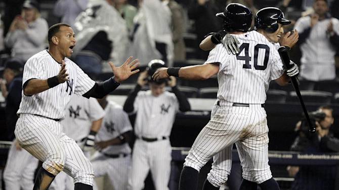 New York Yankees' Alex Rodriguez, left, celebrates with Francisco Cervelli (40) and Ichiro Suzuki, right, of Japan, after Cervelli scored on an RBI single from Raul Ibanez in the 12th inning of a baseball game against the Boston Red Sox, Tuesday, Oct. 2, 2012 in New York. The Yankees won 4-3. (AP Photo/Frank Franklin II)