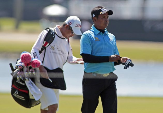 Thailand's Thaworn Wiratchant walks with his caddie on the 10th fairway during second round play in the 2013 WGC-Cadillac Championship PGA golf tournament in Doral
