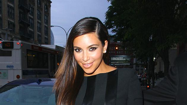 Kim Kardashian dresses her baby bump in a body-con black dress and looks glowing. Copyright [Splash]