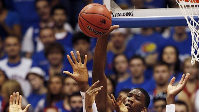 Jayhawks slog their way to exhibition win