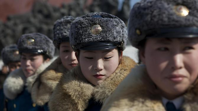 Female North Korean traffic police officers gather in front of bronze statues of the late leaders Kim Il Sung and Kim Jong Il to pay their respects in Pyongyang, North Korea on Saturday, Feb. 16, 2013. North Koreans turned out to commemorate what would have been the 71th birthday of Kim Jong Il who died on Dec. 17, 2011. (AP Photo/David Guttenfelder)