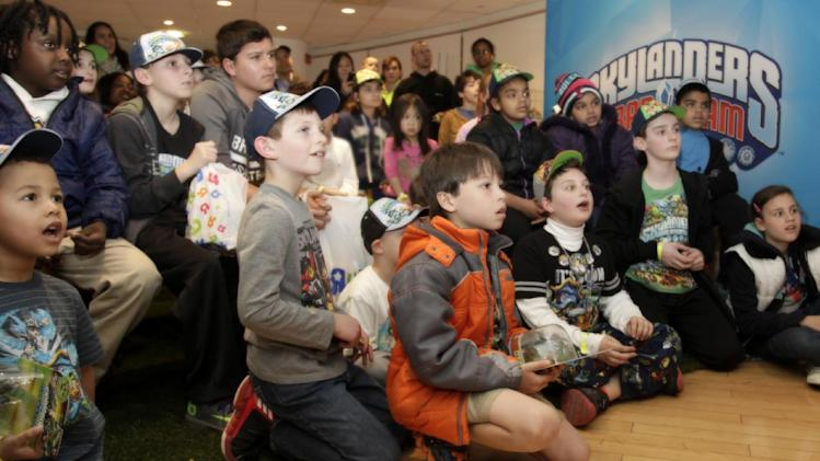 "Kids react to a special reveal of Skylanders Trap Team as part of Skylanders Day on April 23, 2014 in New York City at Toys""R""Us Times Square, where consumers were the first in the world to experience Skylanders Trap Team before the general public. Skylanders Trap Team, the newest video game in the popular Skylanders franchise, reverses the magic of bringing toys-to-life with ground-breaking innovation that allows kids to pull the characters out of the digital world into the physical world. (Photo by Andy Kropa/ Invision for Activision /AP Images)"