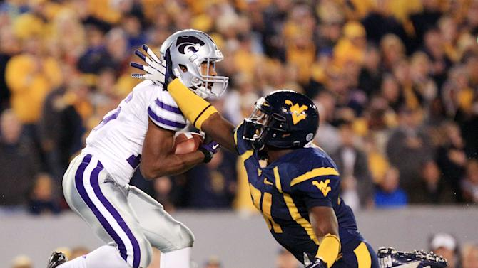 Kansas State wide receiver Tyler Lockett, left, catches a pass next to West Virginia linebacker Isaiah Bruce (31) during the first quarter of an NCAA college football game in Morgantown, W.Va., Saturday, Oct. 20, 2012. (AP Photo/Christopher Jackson)