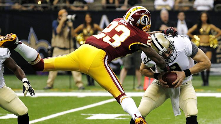 New Orleans Saints quarterback Drew Brees (9) is sacked by Washington Redskins cornerback DeAngelo Hall (23) in the first half of an NFL football game in New Orleans, Sunday, Sept. 9, 2012. The Redskins won 40-32. (AP Photo/Bill Haber)