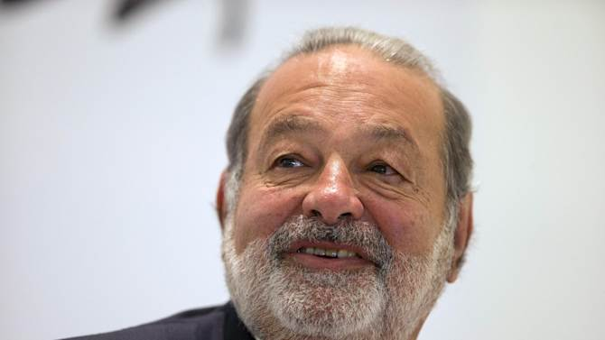 FILE - In this Jan. 14, 2013 file photo, Mexican telecommunications tycoon Carlos Slim speaks during news conference at the Soumaya museum in Mexico City. Slim is scheduled to give the closing speech on Sunday, Aug. 17, 2014, at the annual conference of the Catholic Association of Latino Leaders. (AP Photo/Dario Lopez-Mills, File)