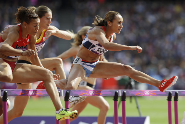 Britain's Jessica Ennis, right, clears a hurdle in the 100-meter hurdles of the Women's Heptathlon at the 2012 Summer Olympics in London Friday, Aug. 3, 2012. (AP Photo/Ben Curtis)