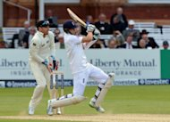 England&#39;s Joe Root bats as New Zealand&#39;s Brendon McCullum acts as wicketkeeper following Bradley-John Watling&#39;s injury which saw him leave the field during the first test at Lord&#39;s Cricket Ground, London