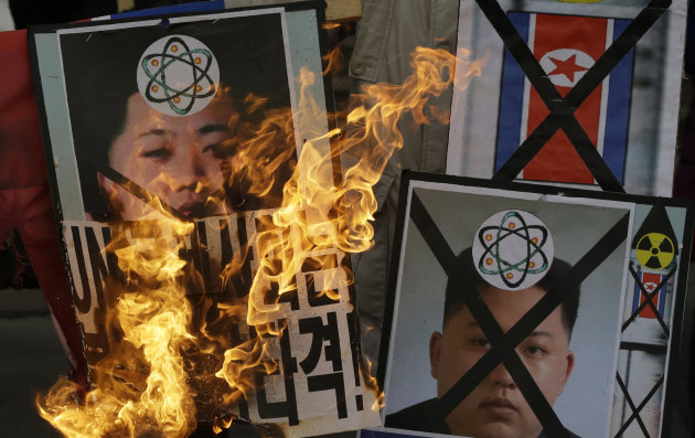 South Korean protesters in in Seoul burn pictures of North Korean leader Kim Jong Un during an anti-North Korea rally following a nuclear test conducted by North Korea Tuesday, Feb. 12, 2013. North Ko