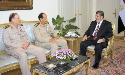 Egypt's first Islamist president Mursi meets with Field Marshal Tantawi and Egyptian Armed Forces Chief of Staff Anan at the presidential palace in Cairo