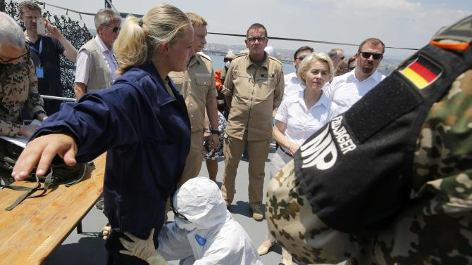 German Defence Minister von der Leyen watches drill for search and rescue operation aboard Schleswig Holstein near harbour of Catania