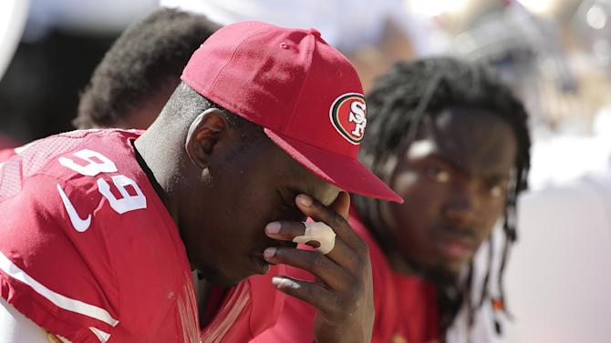 In this Aug. 17, 2014, file photo, San Francisco 49ers linebacker Aldon Smith (99) sits on the sideline during the second half of an NFL preseason football game against the Denver Broncos in Santa Clara, Calif. Aldon Smith has been suspended for nine games by the NFL after a series of off-field legal issues. A statement Friday, Aug. 29, 2014, from the league said Smith had violated the NFL's substance abuse and personal conduct policies