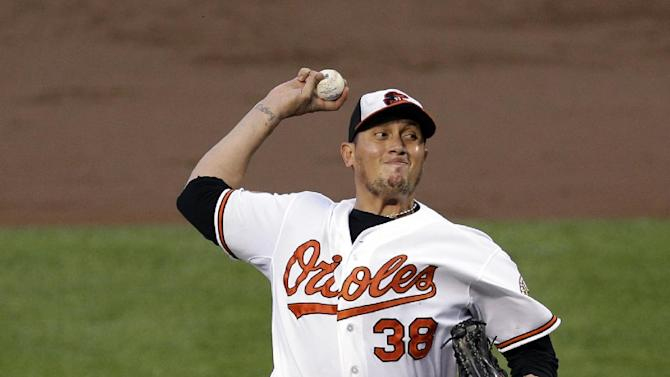 Baltimore Orioles starting pitcher Freddy Garcia throws to the New York Yankees in the third inning of a baseball game in Baltimore, Monday, May 20, 2013. (AP Photo/Patrick Semansky)