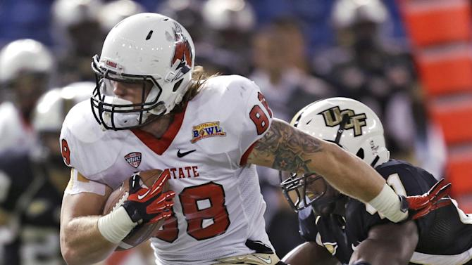 Ball State tight end Zane Fakes (88) pushes off Central Florida linebacker Terrance Plummer after a reception during the second quarter of the Beef 'O' Brady's Bowl NCAA college football game Friday, Dec. 21, 2012, in St Petersburg, Fla. (AP Photo/Chris O'Meara)