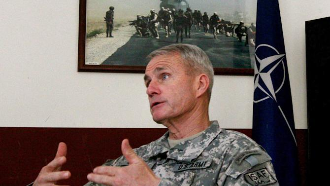 FILE - In this Monday, June 11, 2007 file photo, U.S. Army Gen. Dan McNeill, then top commander of U.S. and NATO forces in Afghanistan, speaks during an interview in Kabul, Afghanistan. McNeill served in 2007-08. Nearly two dozen generals have commanded troops from the United States and the NATO-led International Security Assistance Force, since the American invasion in late 2001. While some analysts say fresh eyes are important, others wonder if the revolving door command has hurt U.S. continuity with critical Afghan partners. (AP Photo/Musadeq Sadeq, File)