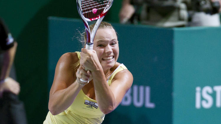 Denmark's Caroline Wozniacki returns to Poland's Agnieszka Radwanska during the WTA championship finals in Istanbul, Turkey, Tuesday, Oct. 25, 2011. Wozniacki beat Radwanska 5-7, 6-2, 6-4. (AP Photo/Vadim Ghirda)