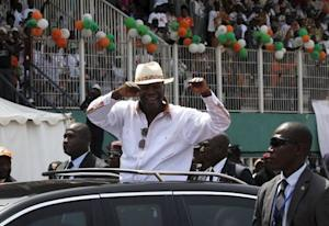 Ivory Coast's President Alassane Dramane Ouattara waves as he arrives for his investiture as  the presidential candidate of RHDP at Felix Houphouet-Boigny Stadium in Abidjan