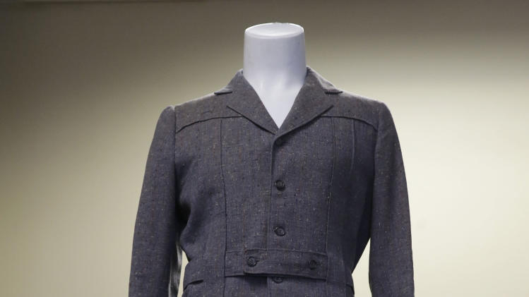 "The grey wool suit Gene Kelly wore in the movie ""Singin' in the Rain"" is displayed at at Heritage Auctions in Dallas, Monday, Dec. 2, 2013. The once rain-soaked suit is going up for auction after being kept in a closet by a memorabilia collector for more than four decades. (AP Photo/LM Otero)"