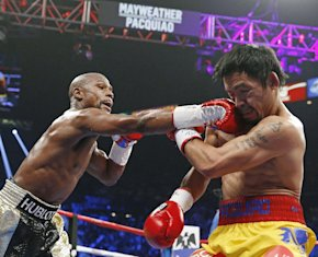 Floyd Mayweather Jr., left, connects with a right to the head of Manny Pacquiao during the first round. (AP)