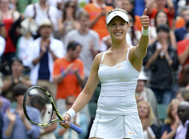 Eugenie Bouchard of Canada reacts after defeating Ana Ivanovic of Serbia in their women's singles tennis match at the Wimbledon Tennis Championships, in London