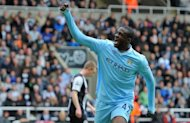 Manchester City midfielder Yaya Toure celebrates a goal against Newcastle on May 6. Manchester United manager Sir Alex Ferguson believes title rivals Manchester City could suffer untold damage if they fail to secure the Premier League on Sunday