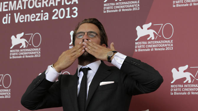 Director Rick Ostermann gestures during the photo call for the movie 'Wolfschildren' at the 70th edition of the Venice Film Festival in Venice, Thursday, Aug. 29, 2013. (AP Photo/Andrew Medichini)