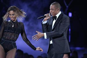 "Beyonce, left, and Jay-Z perform ""Drunk in Love"" …"
