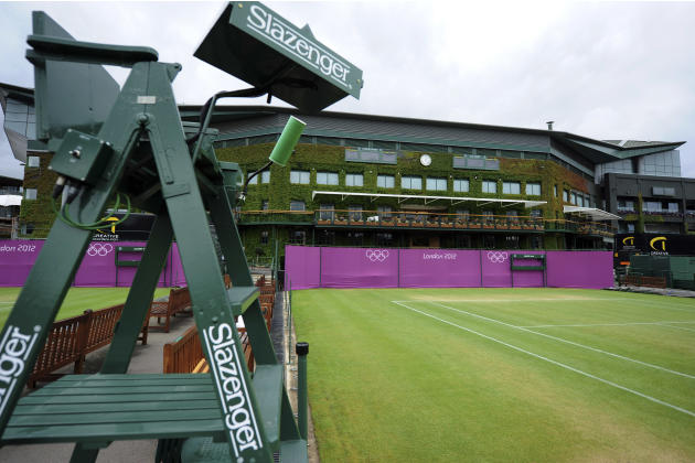 Olympic hoarding is seen on Court Six of the All England Lawn Tennis Club as preparations are made for the London 2012 Olympic Games, in London