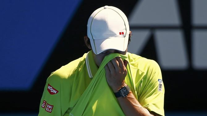 Nishikori of Japan reacts after missing a shot to Wawrinka of Switzerland during their men's singles quarter-final match at the Australian Open 2015 tennis tournament in Melbourne