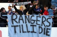 Rangers&#39; fans show their support for the club during the Scottish Premier League match between Rangers and Kilmarnock at Ibrox Stadium in Glasgow on February 18. Chairmen of rival clubs arrived for a meeting regarding the future of financially stricken Glasgow giants Rangers insisting it would not be the end of Scottish football if they were demoted to the Third Division