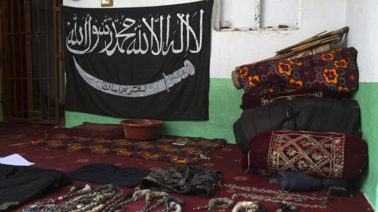 A black Jihad flag, handcuffs and chains are displayed in a house used by Taliban militants as a prison after a military operation against the militants in the town of Miranshah in North Waziristan
