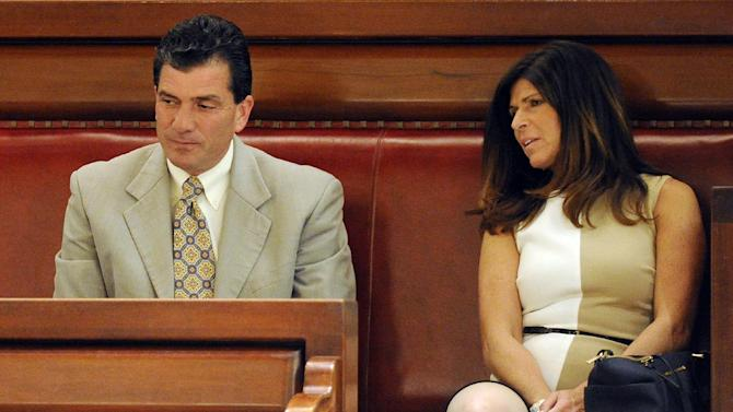 Mark Grisanti ,left, and his wife Maria Grisanti wait as Mark is confirmed as a new judge for the New York Court of Claims during a senate session on Tuesday, May 5, 2015, at the Capitol in Albany, N.Y. (AP Photo/Hans Pennink)