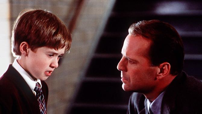 "FILE - In this undated film image originally released by Spyglass Entertainment, Haley Joel Osment, left, and Bruce Willis appear in a scene from the film ""The Sixth Sense,"" a tale of a child who can see ghosts. (AP Photo/Spyglass Enterainment, Ron Phillips)"
