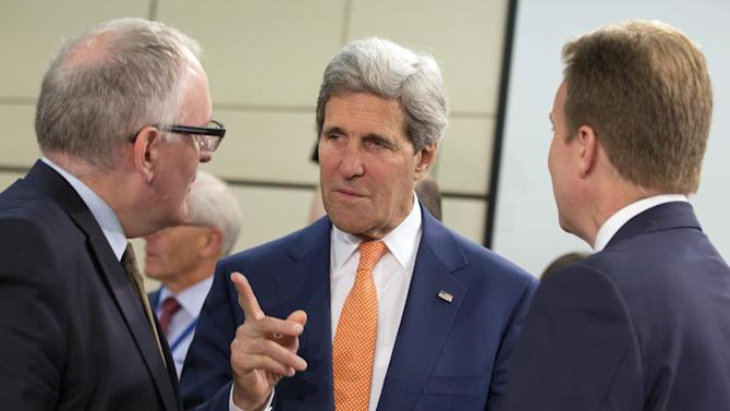 U.S. Secretary of State John Kerry, center, speaks with Dutch Foreign Minister Frans Timmermans, left, and Norwegian Foreign Minister Borge Brende, during a meeting of the North Atlantic Council in Foreign Ministers Session at NATO headquarters in Brussels on Wednesday, June 25, 2014. The Brussels meeting is the final gathering of high-ranking government officials before the summit of NATO's leaders scheduled for September in Wales. U.S. Secretary of State John Kerry and his colleagues are expected to fine tune the summit's agenda on a wide array of topics, from how to redeploy NATO's forces in response to Russian capabilities and actions to what to do in Afghanistan when NATO's combat mission in that country comes to an end this December. (AP Photo/Virginia Mayo)