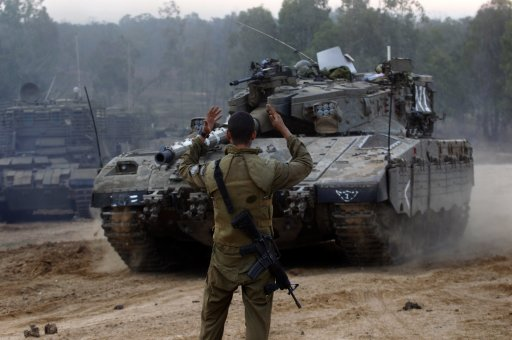 Israeli soldier guides tank at the Gaza border