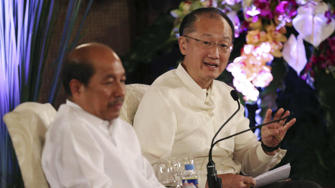 World Bank President Dr. Jim Yong Kim, right, answers questions beside Philippine Budget Secretary Florencio Abad during a forum called the Daylight Dialogue: The Good Governance Challenge at the Malacanang Presidential Palace in suburban Manila, Philippines on Tuesday, July 15, 2014. (AP Photo/Aaron Favila, Pool)