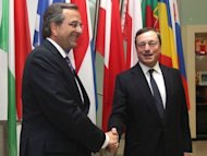 <p>Greece's prime minister Antonis Samaras (L) shakes hands with European Central Bank (ECB) President Mario Draghi, as he arrives for a meeting in Frankfurt am Main, on September 11. Greece needs a two-year extension from its international creditors to meet fiscal pledges, and a liquidity boost from the European Central Bank, said Samaras.</p>