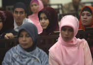 "In this Saturday, June 18, 2011 photo, Muslim women listen to a speech during the launching ceremony of ""Klub Taat Suami,"" or ""Obedient to Husband Club,"" at a restaurant In Jakarta, Indonesia. The new club that aims to encourage women to be pious and totally obedient to their husbands has generated an outcry from some activists. (AP Photo/Dita Alangkara)"